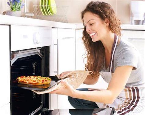 Happy Young Woman Cooking Pizza at Home - Radin Malin Blog